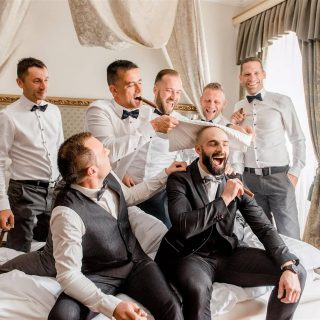 Who do you think is having more fun 🥂🍾😁? . . . . . #bridalparty #bridesmaids #groomsmen #groom #party #havingfun #weddingparty #gettingready #funfunfun #bridesquad #groomsquad #cheers